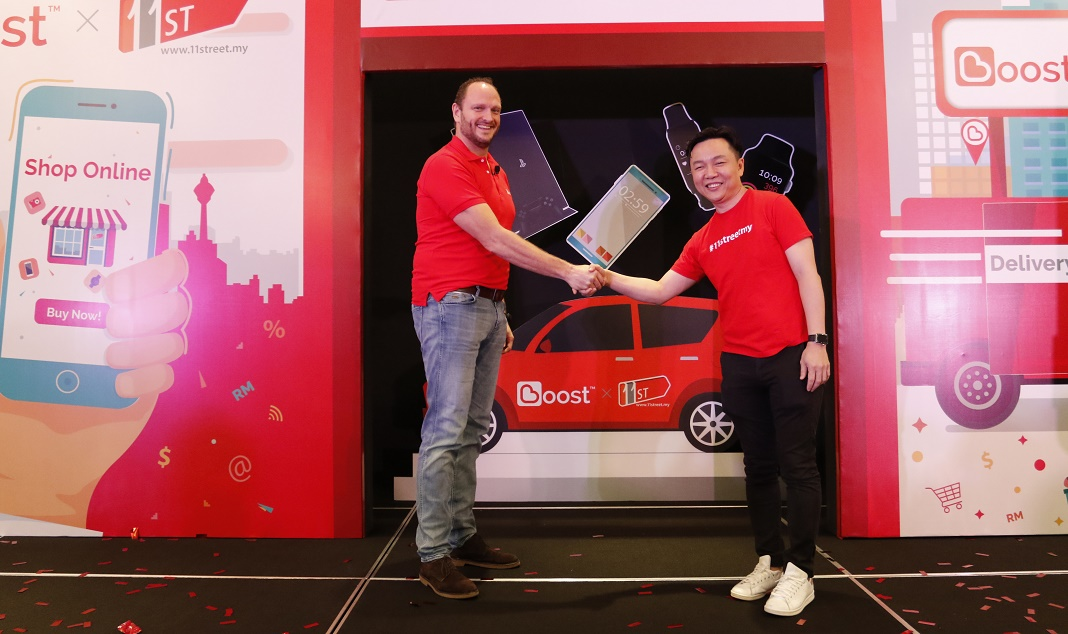 Boost CEO Christopher Tiffin (left) with 11street CEO and Cheong Chia Chou